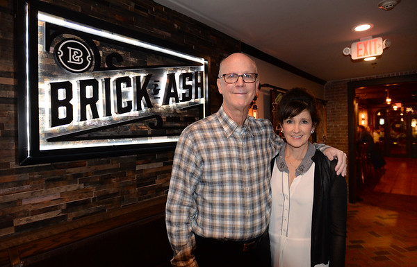 BRYAN EATON/Staff photo. Brick and Ash owners John and Laura Wolfe were greeting customers on their opening night on Monday.