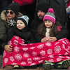 JIM VAIKNORAS/Staff photo Cindy and Robert Kenyon along with their kids Robbie, 4, and Mya,6 wait for Santa in Market Square Saturday afternoon at Amesbury's annual Santa Parade.