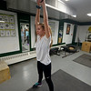JIM VAIKNORAS/Staff photo Two miler Grace Giannatsis lifts weights at  Pentucket High School girls track practice.