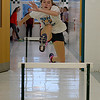 JIM VAIKNORAS/Staff photo Sage Tedesco practices the hurtles in a hall way during  Pentucket High School girls track practice.