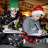 "BRYAN EATON/Staff photo. Students in Lisa Bissell and Bethany Marshall's classes got together in pajamas to watch The Polar Express followed by having some hot chocolate on Thursday. The also had an assignment to write out ideas on ""If I Was an Elf"" which Jake Kramich, left, and Michael Coco were doing."