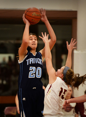 BRYAN EATON/Staff photo. Newburyport hosts Triton girls basketball. Triton forward Tessa Lafrance looks for two points as Newburyport's Krysta Padellaro covers.