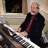 BRYAN EATON/Staff photo. Local favorite Bob Allison entertains with Christmas classics.