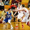 BRYAN EATON/Staff photo. Amesbury plays Georgetown at Triton in the Rowinski Holiday Tournament. Georgetown's Matt Scearbo runs into Amesbury defense.