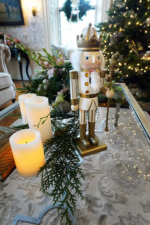 BRYAN EATON/Staff photo. Two of the homes on the Holiday House Tour to benefit the Custom House Maritime Museum. A nutcracker is part of the centerpiece on the coffee table in the Clay home.