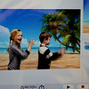 BRYAN EATON/Staff Photo. Students in Bruce McBrien's technology classes are using a new studio with a green screen and with computer magic, students can look like they're in the tropics or anywhere else. Alexa Lindsay, 6, left, and Hayden Lowell, 5, shown on a monitor as they appear to be on a beach.