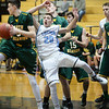 BRYAN EATON/Staff photo. Triton boys host North Reading in basketball. A North Reading player gets the ball from Triton's Dylan Shute on a rebound.