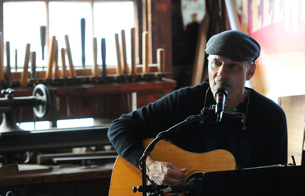 JIM VAIKNORAS/ staff photo Bob Brun of Stellwagen perform at the annual Holiday Open House at Lowell Boat shop in Amesbury this weekend. Along with music the event included an art sale, silent auction, chowder, and wood crafts.