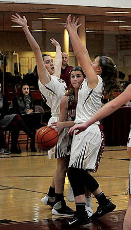 JIM VAIKNORAS/Staff photo  Gloucester's Whitney Schrock squeezes through Newburyport defenders during their game at Newburyport High school Wednesday night.