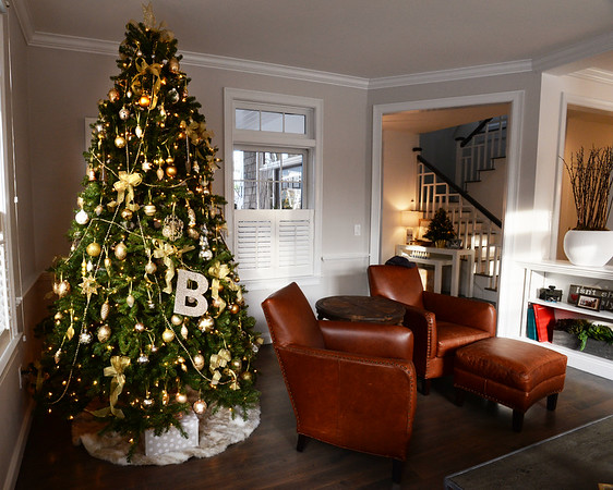 BRYAN EATON/Staff photo. Two of the homes on the Holiday House Tour to benefit the Custom House Maritime Museum. Christmas tree in the Anderson home.