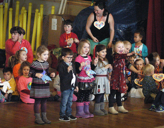 """BRYAN EATON/Staff photo. This group of youngsters from the Newburyport Montessori School sing Bob Marley's """"Three Little Birds"""" on Wednesday morning. They were at the school's annual Peace Gathering held upstairs at Newburyport City Hall."""