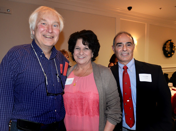 BRYAN EATON/Staff photo. Former Salisbury selectman and Salisbury Chamber of Commerce vice chair Fred Knowles with chairman Donna Abdulla and her husband Fred of Joe's Playland.