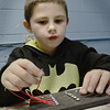 BRYAN EATON/Staff photo. Robert Chernick, 7, creates a circuit board in the Science Club at the Boys and Girls Club. They were making electric matching games under the direction of counselor Josh Cote.