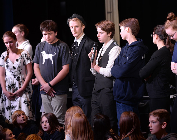 BRYAN EATON/Staff photo. Vincent McKeown as George Bailey and the rest of the cast of It's a Wonderful Life answer questions after a couple short scenes to the a showing for the student body Thursday morning.