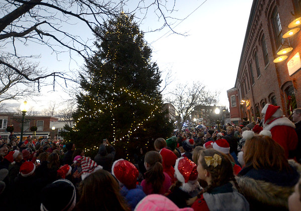 JIM VAIKNORAS/Staff photo The tree is lit in Market Square at the end of  Amesbury's annual Santa Parade.