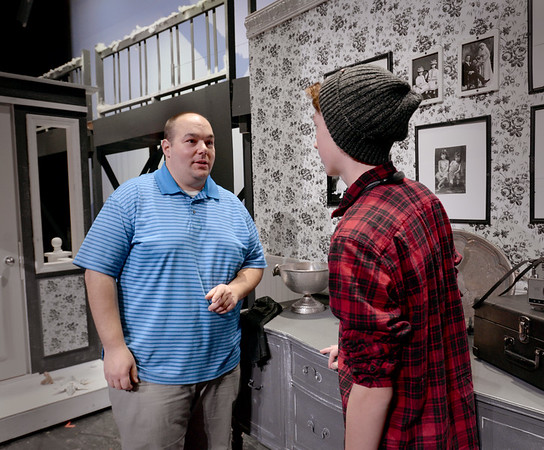 BRYAN EATON/Staff photo. It's a Wonderful Life director Mike Pirollo works with Christian Kjaer who plays Sam Wainwright in the Nock Middle School in Newburyport production.