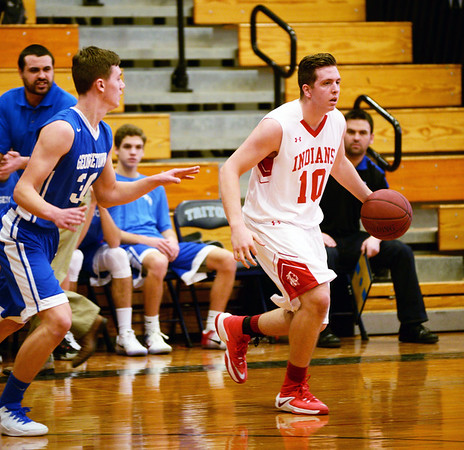 BRYAN EATON/Staff photo. Amesbury plays Georgetown at Triton in the Rowinski Holiday Tournament. Amesbury's William Parady moves down court.