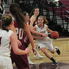 JIM VAIKNORAS/Staff photo Newburyport's Olivia Olson drives to the basket against Gloucester during their game at Newburyport High school Wednesday night.