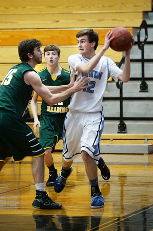 BRYAN EATON/Staff photo. Triton boys host North Reading in basketball. Triton's Colin Brennan gets pressure from a North Reading player.