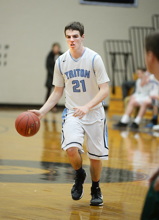 BRYAN EATON/Staff photo. Triton boys host North Reading in basketball. Triton's John McCarthy moves down court.