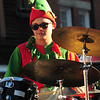 JIM VAIKNORAS/Staff photo John Davis plays tthe drums with the Pentucket Percussion ensemble during the  Annual Merrimac Santa Parade.