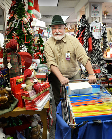BRYAN EATON/Staff photo. Jonathan Meath, who plays Santa Claus in soft drink commercials, also volunteers to deliver mail at the Anna Jaques Hospital, leaves the gift shop.