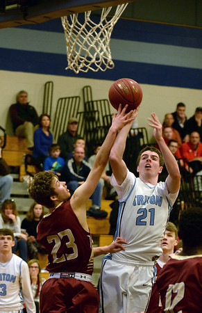 BRYAN EATON/Staff photo. Triton plays Newburyport at Triton in the Rowinski Holiday Tournament. Newburyport's Brendan Powers fouls Triton's John McCarthy.