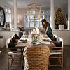 BRYAN EATON/Staff photo. Two of the homes on the Holiday House Tour to benefit the Custom House Maritime Museum. Interior designer Katie Goodrich created the tablescape in the Anderson home.
