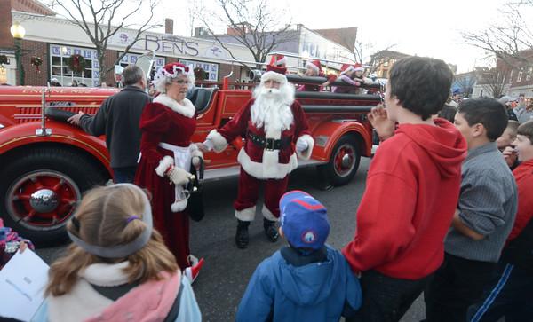 JIM VAIKNORAS/Staff photo Santa and Mrs Claus arrive at the tree lighting at the Amesbury Santa Parade Saturday.
