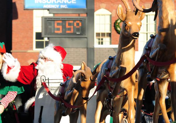 JIM VAIKNORAS/Staff photo Santa arrives at the Merrimac Santa parade on a 55 degree afternoon Sunday.