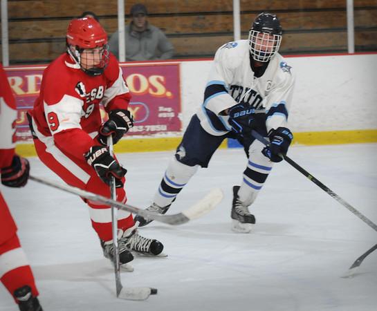 BRYAN EATON/Staff Photo. Amesbury's Brendan Foley moves into Triton ice Saturday at the Graf Rink.