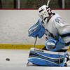 BRYAN EATON/Staff Photo. Triton goalie Nolan Smith stops this shot on net by Cohasset.