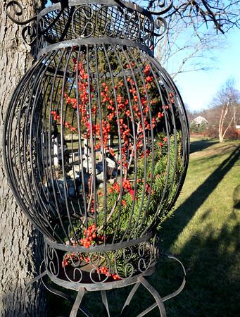 BRYAN EATON/Staff Photo. Brenda Bradley's decorative birdcage.