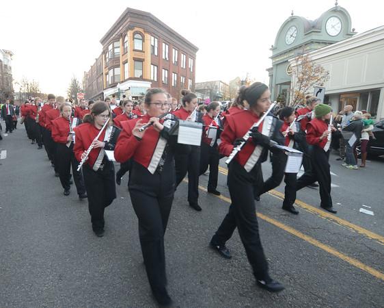 JIM VAIKNORAS/Staff photo The Amesbury high school band makes his way down Main Street in the Amesbury Santa Parade Saturday.
