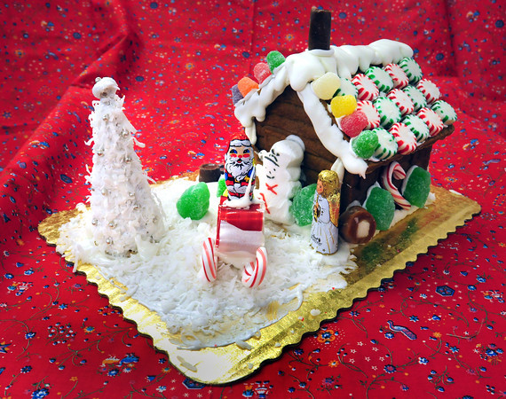 Newburyport: Paula Chambers' gingerbread house has a chocolate Santa Claus on a sleigh. Bryan Eaton/Staff Photo