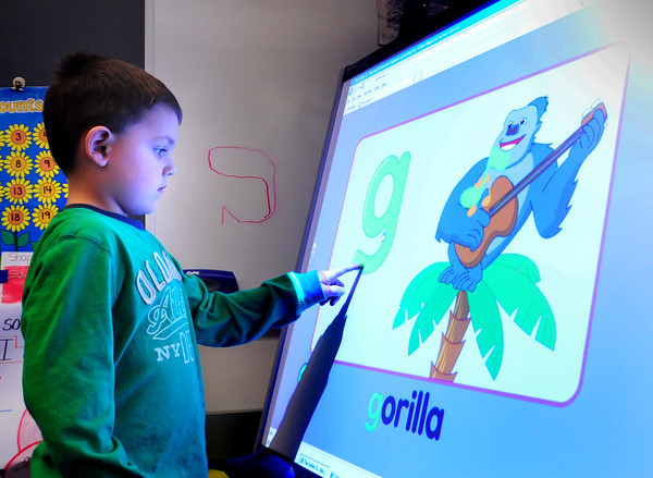 "Salisbury: Pre-kindergartner Colin Savard, 5, uses a new Smartboard checking out what things begin with the letter ""g"" at Salisbury Elementary School. Each of the pre-kindergartner classes in the Triton School District received one of the units which were donated by and anonymous grandparent from the district. Bryan Eaton/Staff Photo"