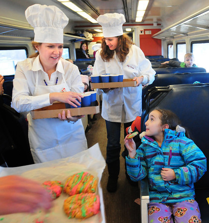 "Newburyport: Olivia Samiosette, 6, and her classmates from the Page School in West Newbury were surprised by school moms serving cookies and hot chocolate in a break from the reading of ""Polar Express"" on the Newburyport commuter line. Bryan Eaton/Staff Photo"