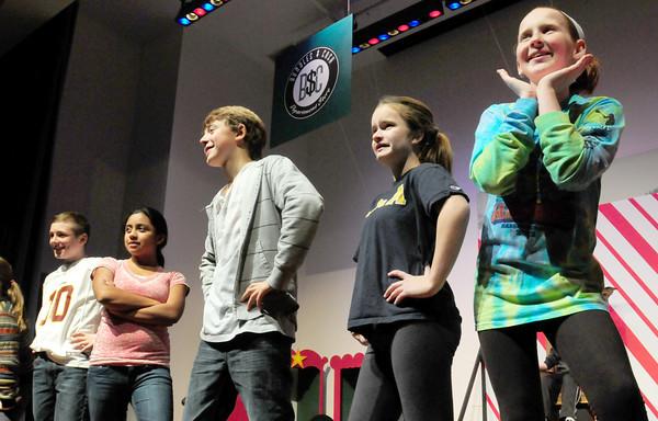 "Newbury: Dancing to ""Mister Santa"" in the tune of ""Mister Sandman"" as the Theatre Workshop rehearses at Newbury Elementary School. Bryan Eaton/Staff Photo"
