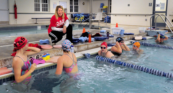 Newburyport: Coach Diane Sagaser watches over members of the swim teams at the Newburyport YWCA. Bryan Eaton/Staff Photo
