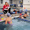Newburyport: Coach Diane Sagaser watches over members of the swim teams at the Newburyport YWCA. Bryan Eaton/Staff Photo