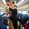 Newburyport: Page School principal Jack O'Mara reads the Polar Express to the West Newbury second-graders on a Newburyport commuter train yesterday morning. This will be the last stint for the retiring principal, donning a conductor's hat, as his last day is Friday. Bryan Eaton/Staff Photo