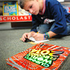 Newburyport: Colin Rafferty, 8, fills in an order to purchase the Guinness World Records 2014 in the library at the Bresnahan School in Newburyport. He was at the Book Fair which raises money for books for the library there. Bryan Eaton/Staff Photo