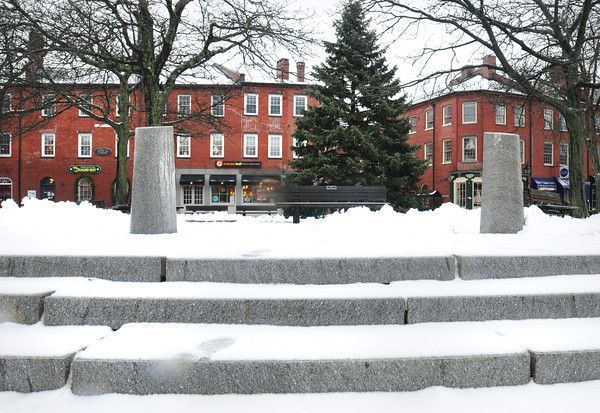 Newburyport: The Christmas tree in Newburyport's Market Square was surrounded by snowfall giving a yuletide feel until the snow turned to rain melting much of it. Bryan Eaton/Staff photo