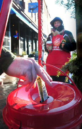 Newburyport: Volunteer Nancy Daigle manned the Salvation Army donation kettle at State and Liberty Streets in downtown Newburyport as several passersby were seen dropping donations in the course of a few minutes. The agency, though, is still falling short of cash during a shortened fundraising season. Bryan Eaton/Staff Photo