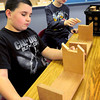 "Rowley: Pine Grove students Dylan Marshall, left, and Nate Ewell, both 9, piece together ""Bookdogs"" which act as bookstand before glueing them together. Bryan Eaton/Staff Photo"