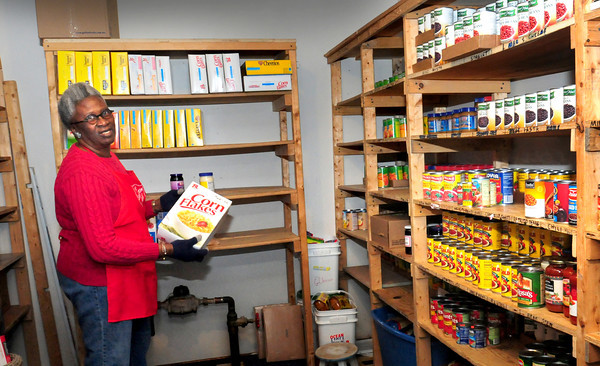 Newburyport: Thurmutis James, a senior soldier at the Salvation Army, tends the food pantry at the Salvation Army. Bryan Eaton/Staff Photo