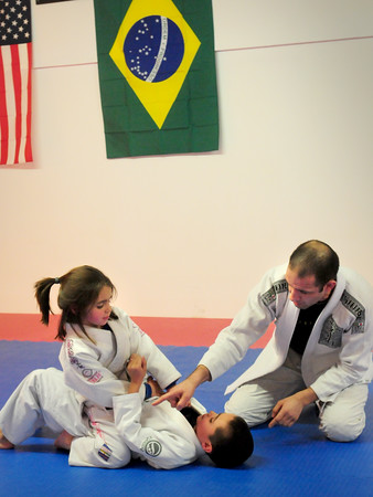 Newburyport: Brazilian trainer Daniel Duarte works with siblings Isabella Cadavid, 6, top and Dylan, 7, at Guy Chase Academy of Martial Arts in Newburyport. Bryan Eaton/Staff Photo