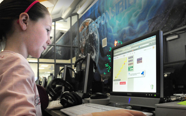 "Amesbury: Carly Gendell, 9, works on the ""Hour of Code"" in the computer lab at Cashman Elementary School in Amesbury on an object imbedded program. Schools all over the country have signed up to participate in the program. Each classroom will spend one hour on computers using kid-friendly tutorials on how to ""code."" Bryan Eaton/Staff Photo"