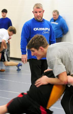 Georgetown: New Georgetown High wrestling coach Ryan Archambault watches over practice.  Bryan Eaton/Staff Photo