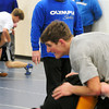 Georgetown: New Georgetown High wrestling coach Ryan Archambault watches over practice.  Bryan Eaton/Staff Photo